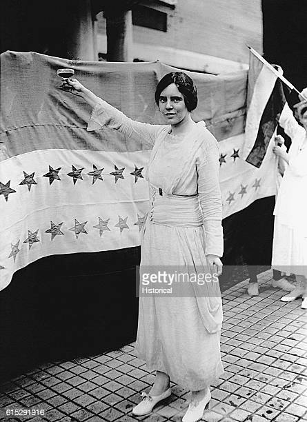 American feminist Alice Paul raises a toast at a women's rally Paul authored the first equal rights amendment considered by Congress in 1923