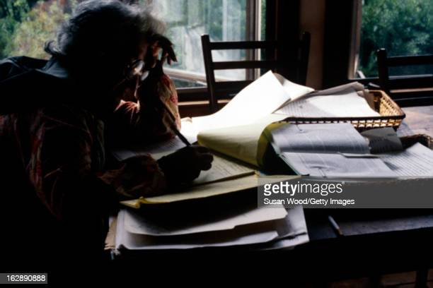 American feminist author and social activist Betty Friedan writes at a desk in her home Sag Harbor New York May 1978