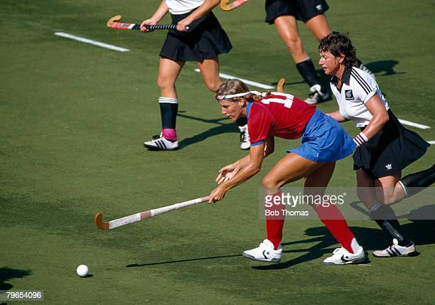 American field hockey player Sheryl Johnson battles for the ball with Catherine Thompson of New Zealand during a United States v New Zealand Women's...