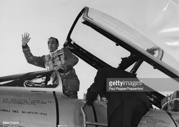 American fighter pilot Commandant James Robinson Risner waves from the cockpit of his Super-Sabre aircraft after commemorating the 30th anniversary...