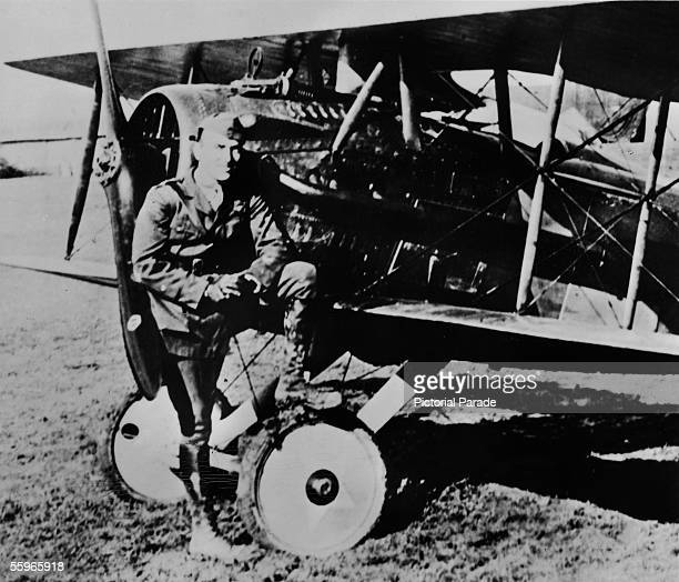 American fighter pilot Eddie Rickenbacker a commanding officer in the US 94th Aero Pursuit Squadron poses in front of a SPAD Scout during World War I...