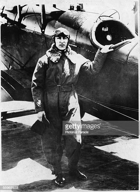 American fighter pilot Eddie Rickenbacker a commanding officer in the US 94th Aero Pursuit Squadron poses next to a fighter during World War I 1910s...