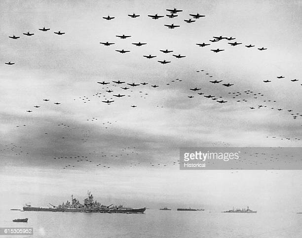 American fighter planes fly in formation over the USS Missouri in Tokyo Bay on September 2 during the ceremony in which Japan signed terms of...