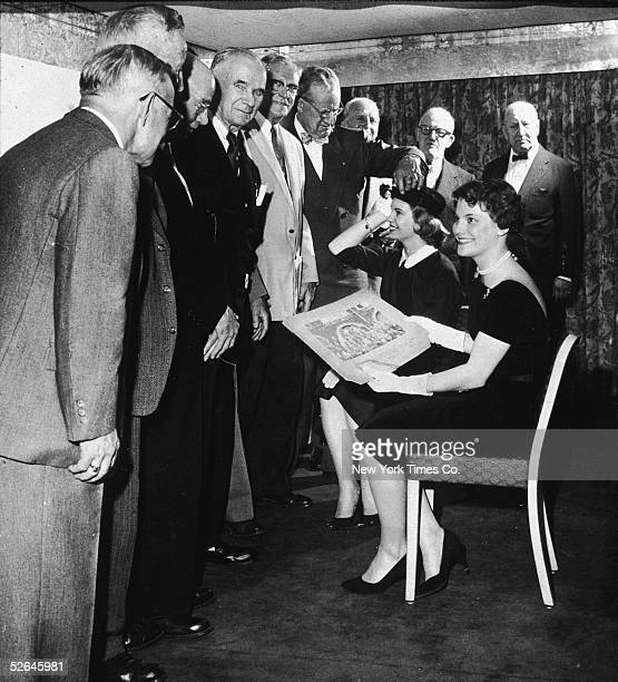 American figure skater Carol Heiss meets with members of the 1908 American Olympic team at the Belmont Hotel New York New York May 9 1958