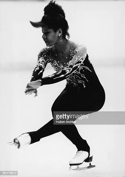 American figure skater Debi Thomas performs a sit spin during competition at the 1988 Winter Olympic games Calgary Alberta 1988 She went on to win...
