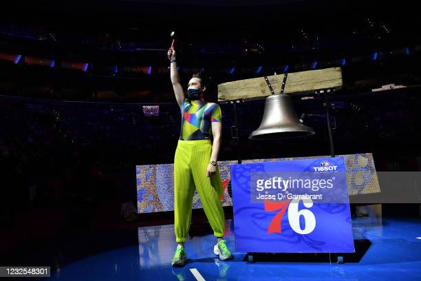 American figure skater, Johnny Weir rings the bell prior to a game on Pride Night between the Oklahoma City Thunder and the Philadelphia 76ers on...