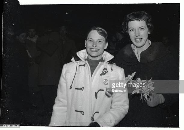 American figure skating champs Tenley Albright of Newton MA and Carol Heiss of Ozone Park NY smile as they leave the ice stadium at Cortina after...