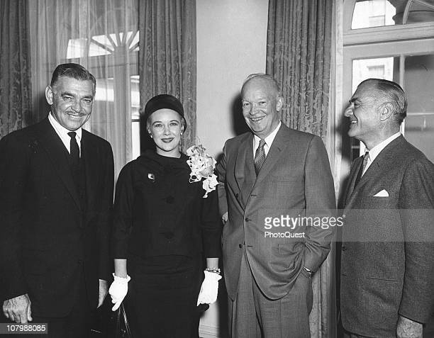 American film actor and screen idol Clark Gable his wife fashion model Kay Gable and film producer William Pearlberg pose in the White House with US...