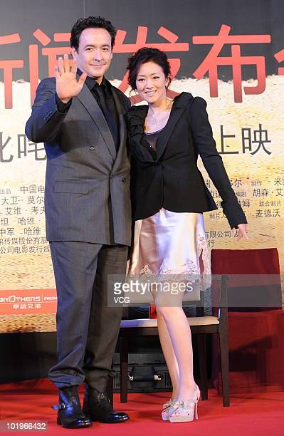 American film actor and screenwriter John Cusack and Chinese actress Gong Li attend a premiere press conference for the film 'Shanghai' on June 10...