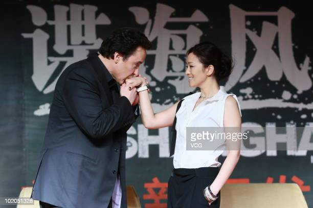 American film actor and screenwriter John Cusack and Chinese actress Gong Li attend a press conference of film 'Shanghai' during the 13th Shanghai...