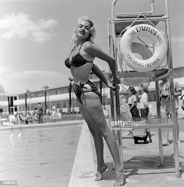 American film actor and sex symbol Jayne Mansfield poses in a bikini by a lifeguard chair at the Dunes Hotel Las Vegas Nevada mid 1950's