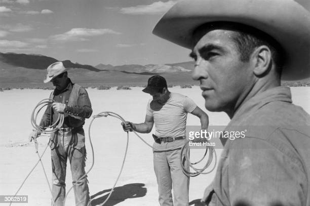 American film actor Clark Gable Eli Wallach and Montgomery Clift on location in the Nevada Desert during the filming of John Huston's 'The Misfits'