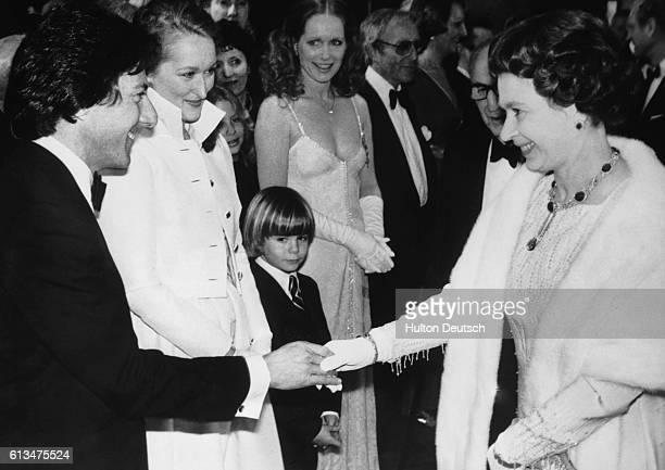 American film actor Dustin Hoffman shakes hands with Queen Elizabeth II at the Royal premiere of Kramer Versus Kramer, London, 1980. Hoffman won an...