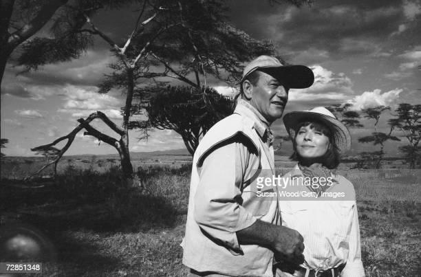 American film actor John Wayne and Italian actress Elsa Martinelli on set in character for the film 'Hatari' directed by Howard Hawks Tanzania 1962