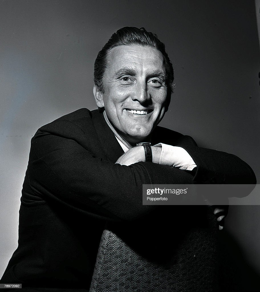 American film actor Kirk Douglas poses for a portrait at the Savoy Hotel in London, 1957. : News Photo
