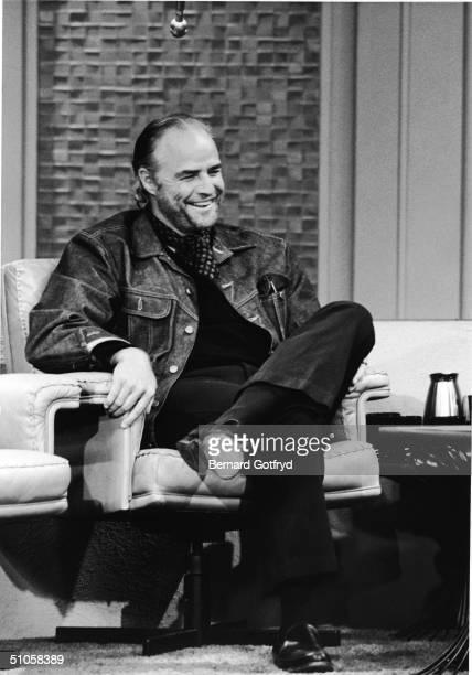 American film actor Marlon Brando cracks a smile on the set of 'The Dick Cavett Show' New York New York June 12 1973