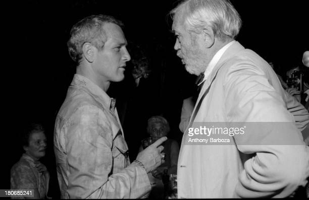 American film actor Paul Newman speaks with director director John Huston at an unspecified event New York New York July 25 1972