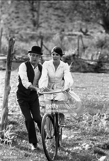 American film actor Paul Newman steadies a bicycle for actress Katherine Ross in a scene from the film 'Butch Cassidy and the Sundance Kid' Durango...