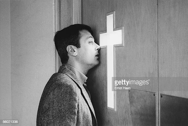 American film actor Tony Curtis peers through a church door before his wedding to his second wife Christine Kaufmann February 1963