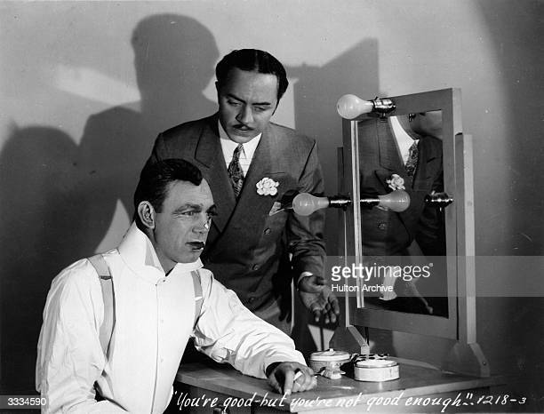American film actors Hal Skelly and William Powell in a dressingroom scene from the Paramount film 'The Dance of Life' adapted from the stage play...