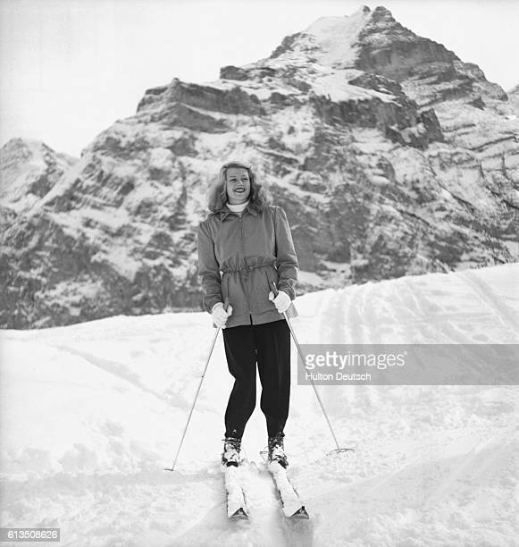 American film actress and dancer Rita Hayworth skiing during her winter holiday at Murren Switzerland in 1949