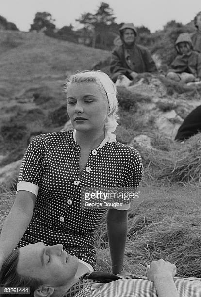 American film actress Barbara Payton with her leading man Stephen Murray during filming of 'The Four Sided Triangle' at Weymouth in Dorset for Hammer...