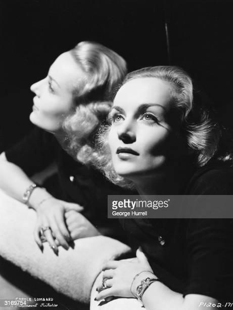 American film actress Carole Lombard reflected in an angled mirror