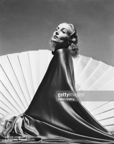American film actress Carole Lombard swathed in silk