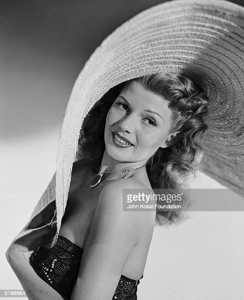 American film actress, dancer and singer Rita Hayworth , known as 'The Love Goddess', wearing a giant sombrero.