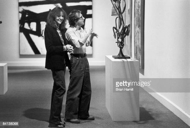 American film actress Diane Keaton laughs as film director actor and writer Woody Allen talks about a sculpture in a museum in a scene from his film...