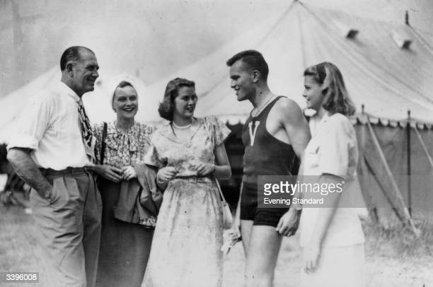 American film actress Grace Kelly centre at Henley Royal Regatta HenleyonThames with her family