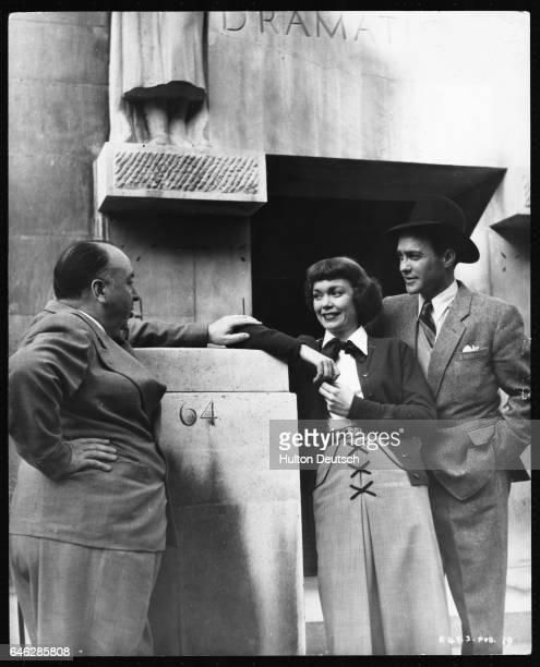 American film actress Jane Wyman with British actor Richard Todd and film director Alfred Hitchcock outside the Royal Academy of Dramatic Art in...