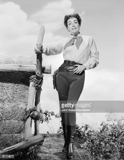 American film actress Joan Crawford in costume for her role in the western 'Johnny Guitar'