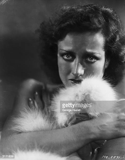 American film actress Joan Crawford is overcome with emotion