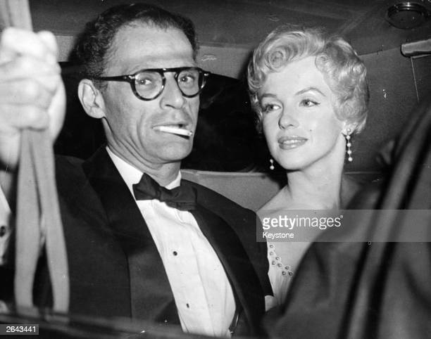 American film actress Marilyn Monroe and her husband American playwright Arthur Miller arrive at the Berkshire home of playwright Terence Rattigan...
