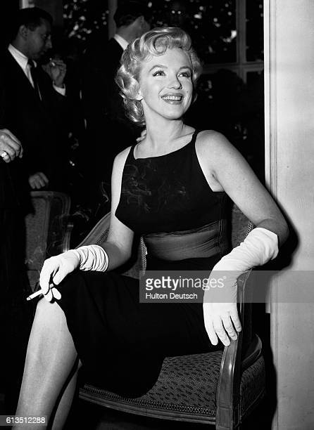 American film actress Marilyn Monroe gives a press conference at the Savoy Hotel in London England 1956 Monroe became a photographer's model in 1946...