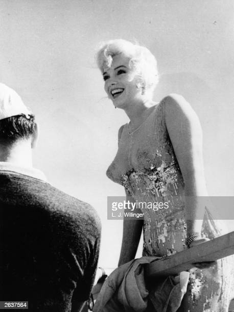 American film actress Marilyn Monroe in between shots on the set of 'Some Like It Hot' directed by Billy Wilder Costume by OrryKelly Original...