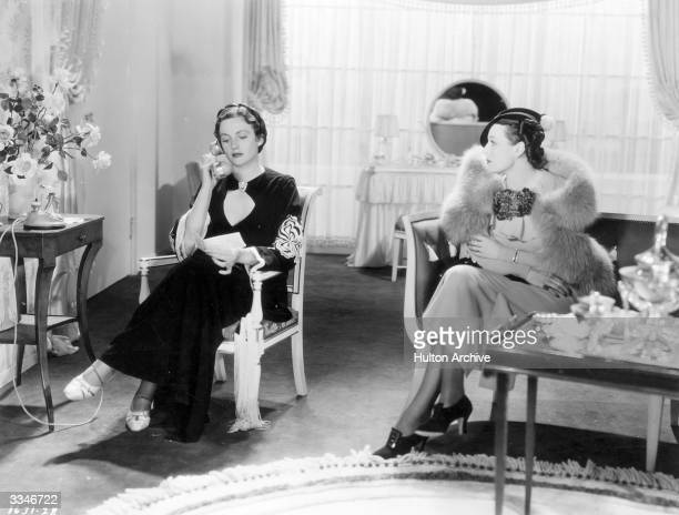 American film actress Marsha Hunt sitting in a lounge with Scottish film actress Frieda Inescort in a scene from 'Hollywood Boulevard' a Paramount...