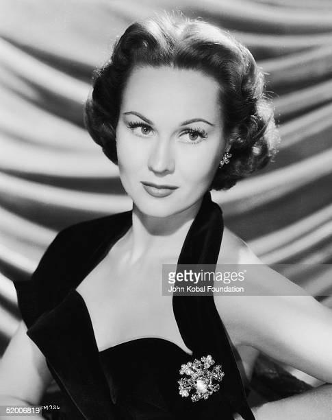 American film actress Virginia Mayo in a black halterneck top circa 1955