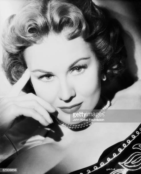 American film actress Virginia Mayo wearing a beaded top and pearl necklace circa 1955