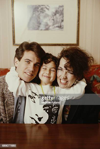 American film and television actor Robby Benson with his wife actress Karla DeVito and their daughter Lyric London 1989