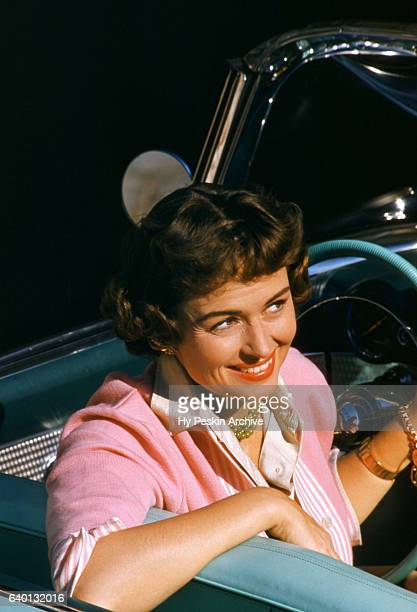 American film and television actress Donna Reed poses for a portrait in a convertible circa March 1955
