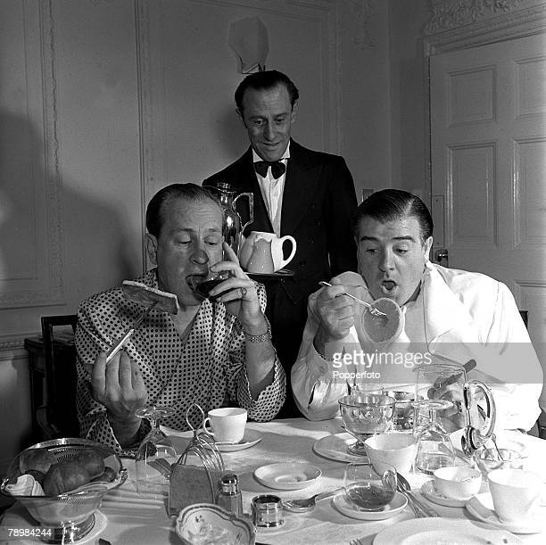 1950 American Film comedians and actors Lou Costello and Bud Abbott are pictured eating breakfast in their hotel room
