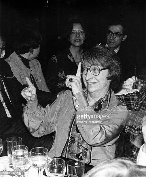 American film critic Pauline Kael smiles and guestures as she sits at a table during the New York Film Critics Awards New York New York