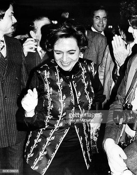 American film critic Pauline Kael smiles as she walks through the crowd at the New York Film Critics Awards New York New York January 20 1974