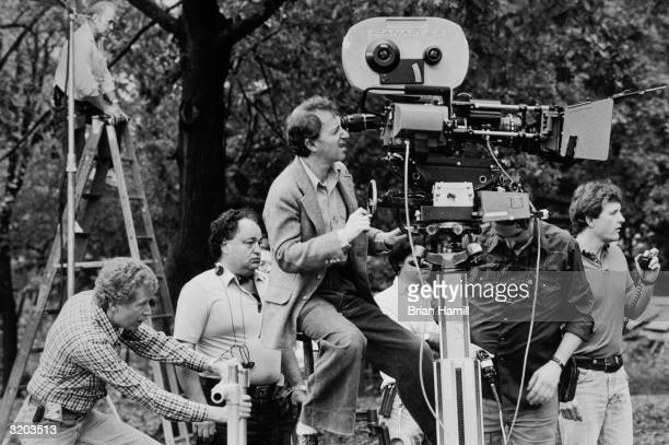 American film director actor and writer Woody Allen sets up a shot on the set of his film 'Hannah and Her Sisters' LR dolly grip Red Burke camera...