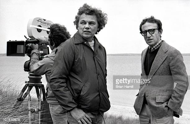 American film director and actor Woody Allen and his cinematographer Gordon Willis talk during the filming of the Allendirected movie 'Annie Hall'...