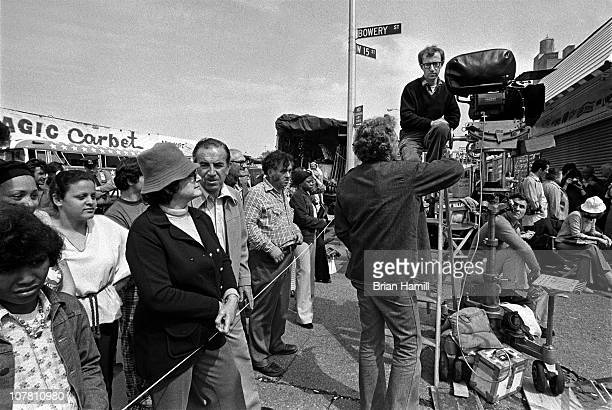 American film director and actor Woody Allen sits atop a ladder and talks with his crew during the filming his movie 'Annie Hall' Coney Island New...