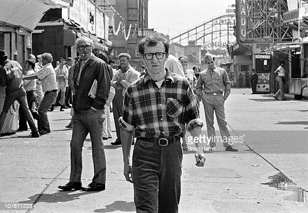 American film director and actor Woody Allen walks through Coney Island in a scene from his movie 'Annie Hall' New York New York 1977
