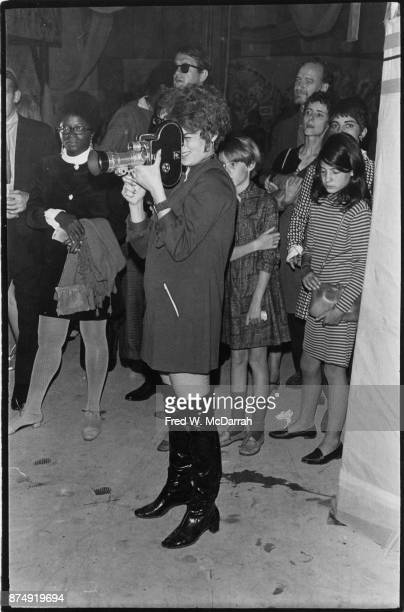 American film director and performance artist Barbara Rubin holds a camera at Filmmakers Cinematheque New York New York September 24 1967 The group...
